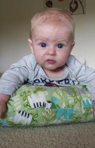 The Boppy Pillow helps him sit up more while on his belly.