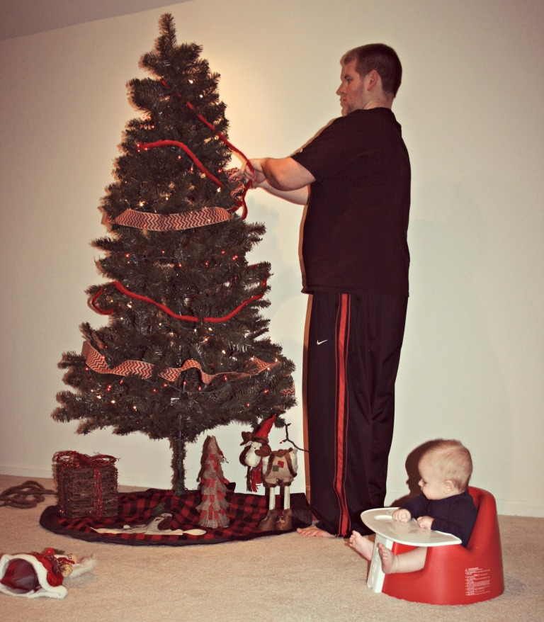 Brent loves to decorate the tree.