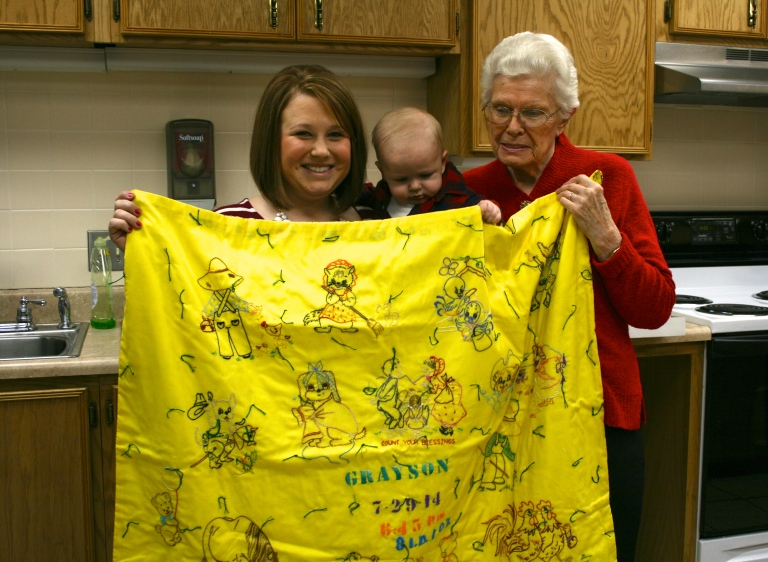 My great grandma, Grayson's great great grandma hand stitched him a blanket! Each one of us grandkids have one.